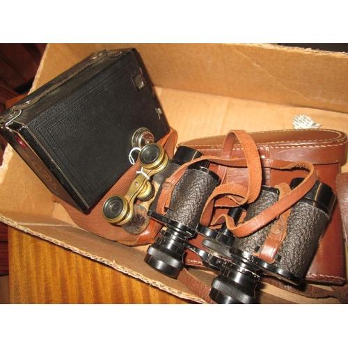 235 - Box Brownie camera, opera glass and French binoculars in case...