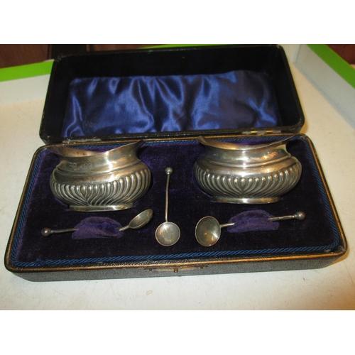 155 - Pair of silver salts in presentation case Birm. 1934 E J Houlston 48 g...