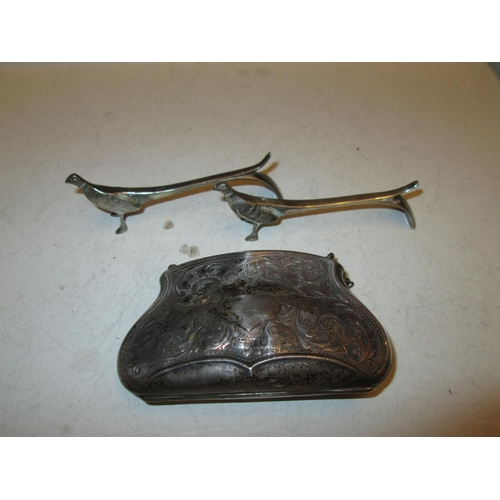 157 - Silver purse, marks worn Birm. 1912 and silver plated pheasant knife rests...