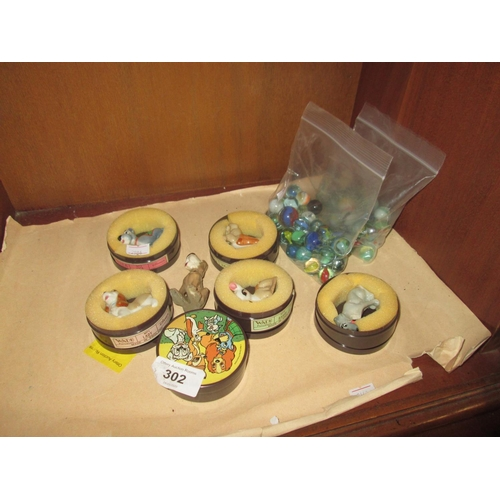 302 - Collection of boxed Wade Disney Whimsies and 2 x bags of marbles...