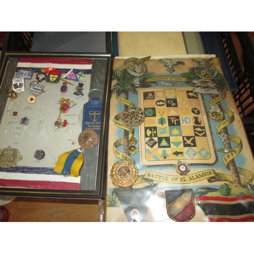 332a - World War II badges mounted as a display...