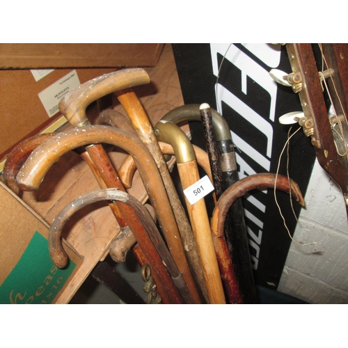 501 - Bundle of various walking sticks, horn and silver rimmed and others...