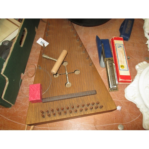 550 - Bowler hat, zither / psaltery and blues harps...