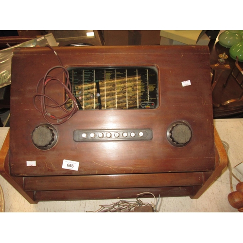 666 - Vintage radio in wooden case...