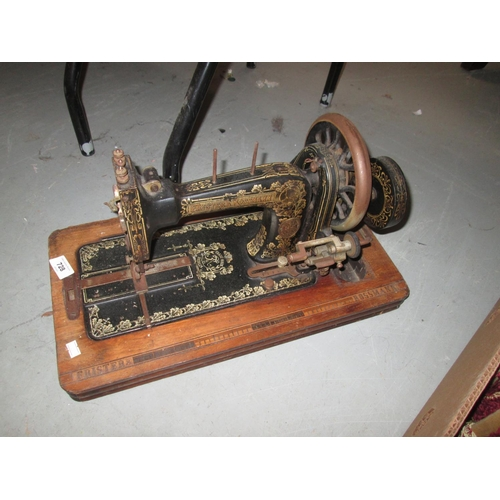 728 - Frister & Rossman sewing machine no case...