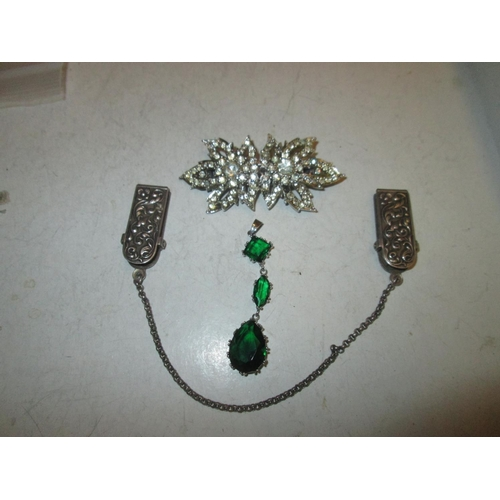 172 - Silver clips, paste buckle brooch and green stone pendant...