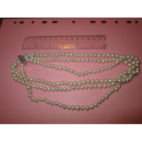 1 - Triple strand pearl necklace...