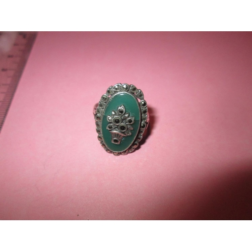13 - Pretty silver (.925), marcasite and green jade coloured stone ring...