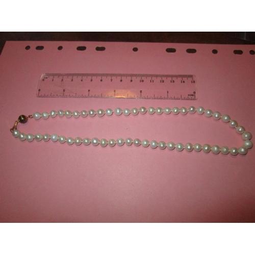 2 - Modern strand of pearls...