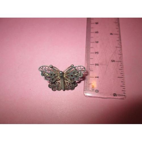 23 - Vintage filigree silver brooch modelled as a butterfly...