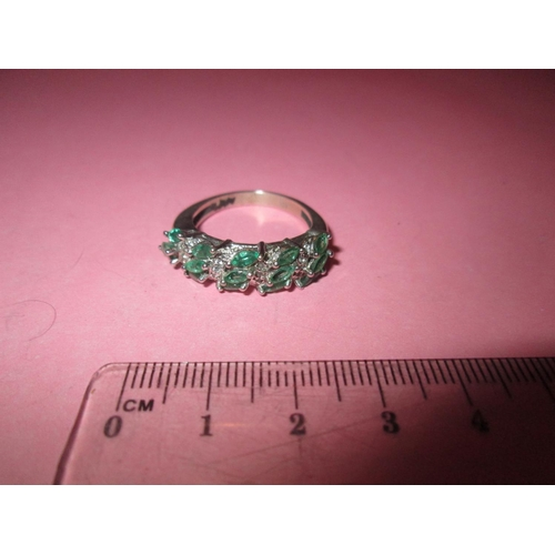 59 - Modern ring set emerald coloured stones set and paste size R (58)...