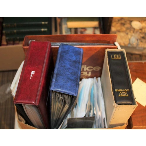 28 - A BOX CONTAINING A SELECTION OF STAMPS, first day covers etc. <br>...