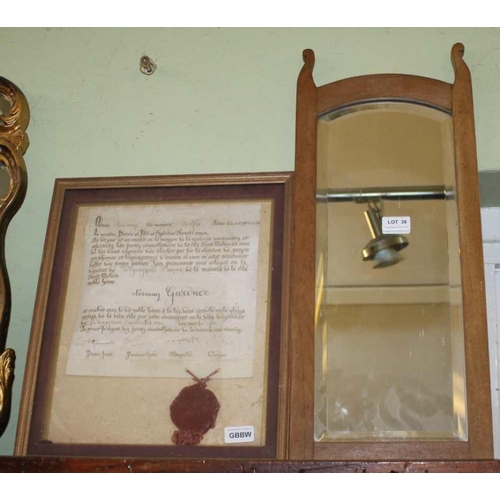38 - A SMALL BEVEL PLATE WOODEN FRAMED WALL MIRROR, together with a glazed and framed Religious document ...