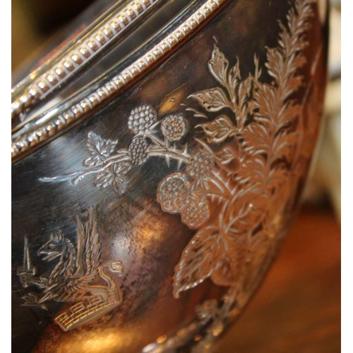 41 - A HALLMARKED SILVER SWING HANDLED PEDESTAL BOAT SHAPED BOWL with engraved armorial crest (249g) <br>...