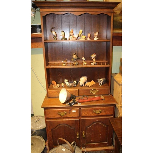 49 - A REPRODUCTION OAK FINISHED DRESSER TYPE UNIT, having plate rack back, with two inline drawers, the ...