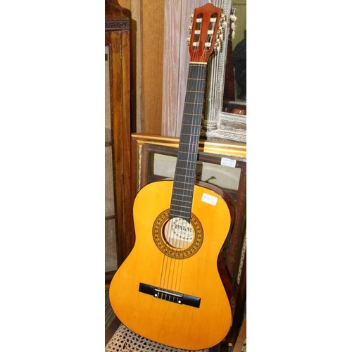 5 - A SMALL WOODEN SPANISH STYLE FLAMENCO GUITAR with a padded gig bag <br>...