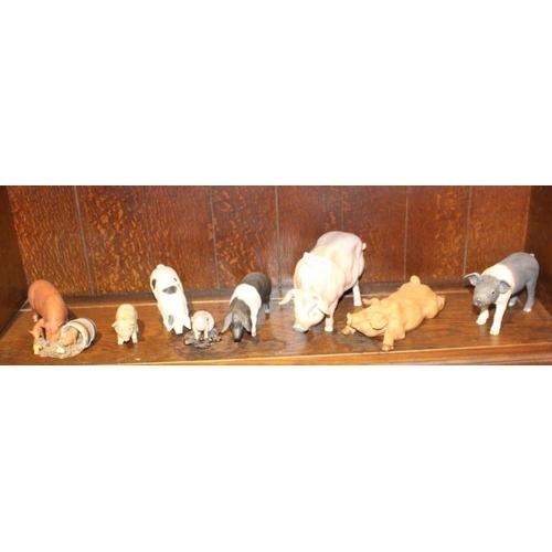 53 - A SHELF FULL OF MODEL PIGS <br>...
