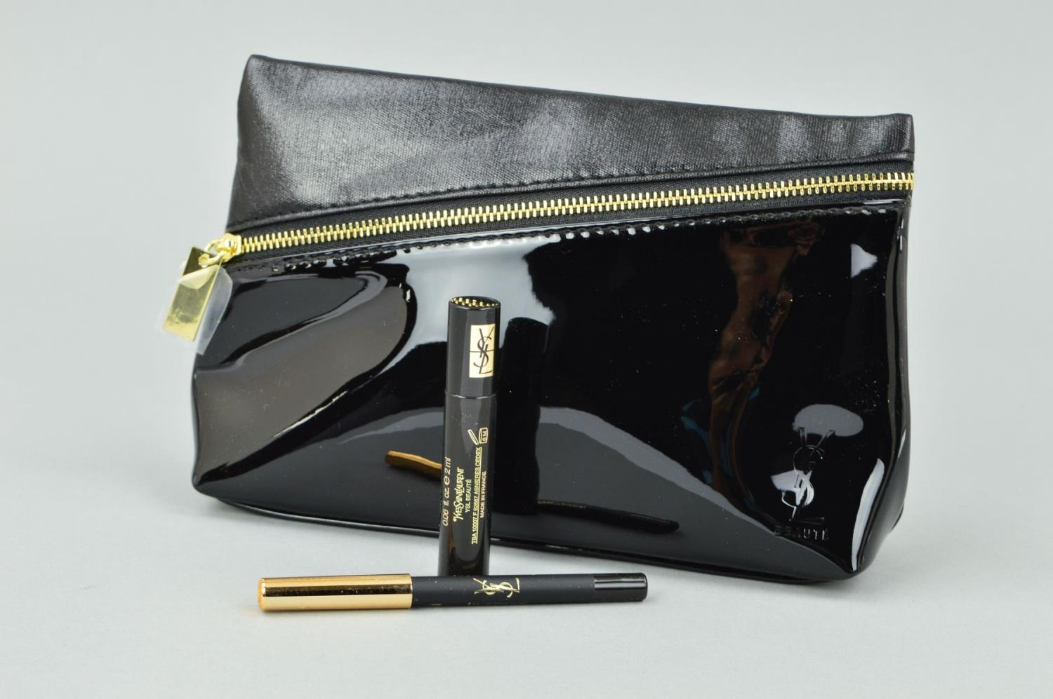 8cc6f297d066f YVES ST LAURENT CLUTCH BAG IN BLACK WITH A YVES ST LAURENT EYE PENCIL
