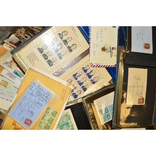 40 - AN ACCUMULATION OF COVERS AND CARDS, in three albums and loose...
