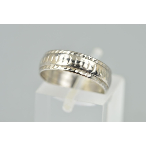 39 - A MID - 20TH CENTURY 18CT WHITE GOLD WEDDING RING, textured pattern, measuring 5.4mm in width, ring ...
