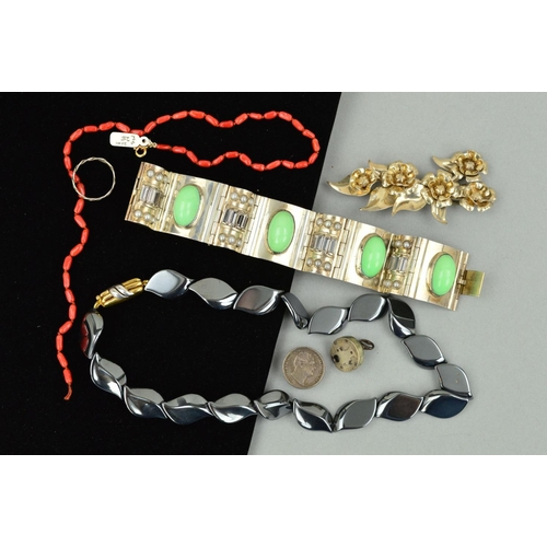 16 - A SELECTION OF JEWELLERY to include a hinged panel bracelet set with green paste cabochons, imitatio...