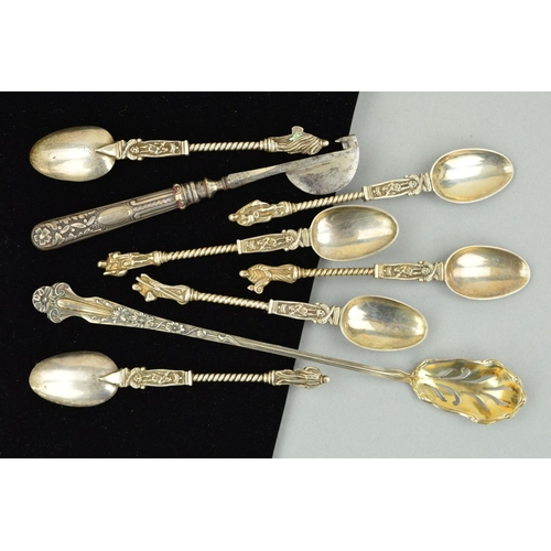 24 - A SELECTION OF SILVERWARE to include a set of six Continental teaspoons, with twist detail and figur...