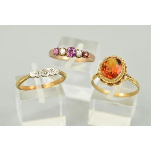 32 - THREE GEM RINGS, the first a three stone, illusion set diamond ring, the central single cut diamond ...