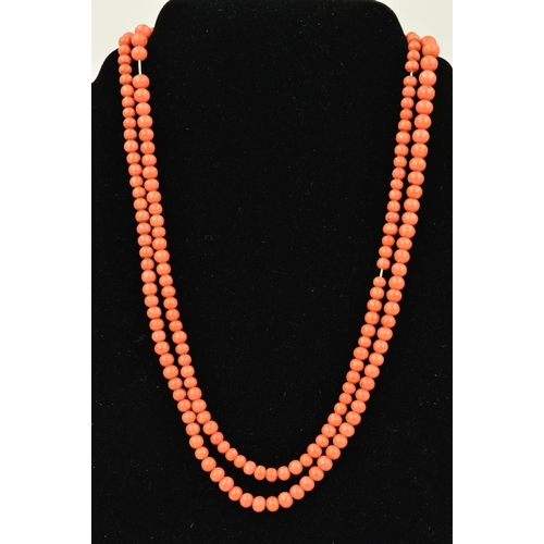 33 - AN EARLY 20TH CENTURY CORAL BEAD NECKLACE, the graduated beads measuring 3mm to 7mm, to the spring r...