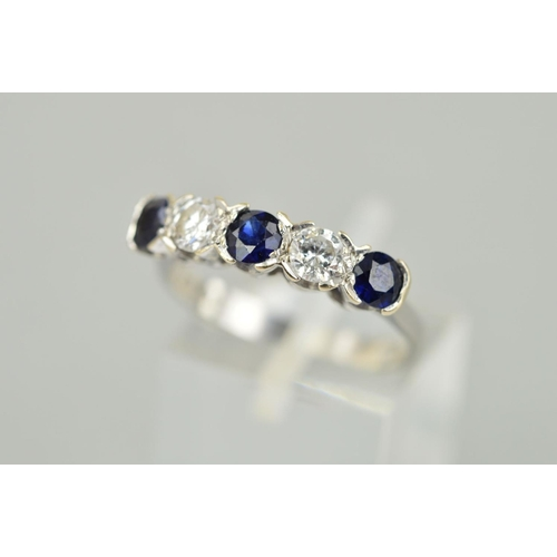 36 - A MID TO LATE 20TH CENTURY SAPPHIRE AND DIAMOND HALF HOOP FIVE STONE RING, estimated modern round br...