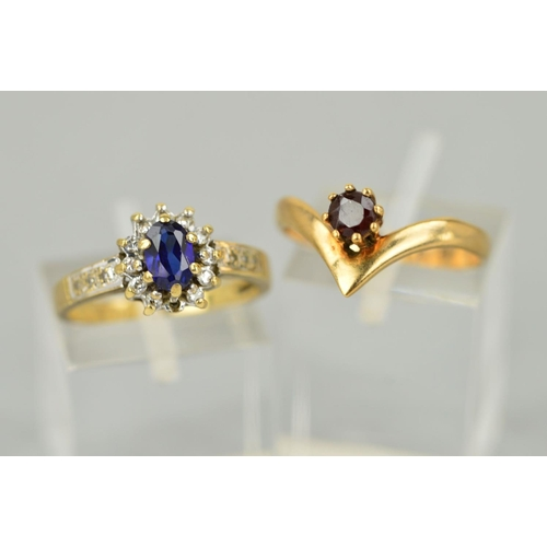 38 - TWO LATE 20TH CENTURY GEM RINGS to include a 9ct gold garnet single stone wishbone ring, ring size O...