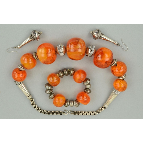 47 - A NECKLACE, BRACELET AND EARRING SUITE, the necklace designed as graduated large orange plastic bead...