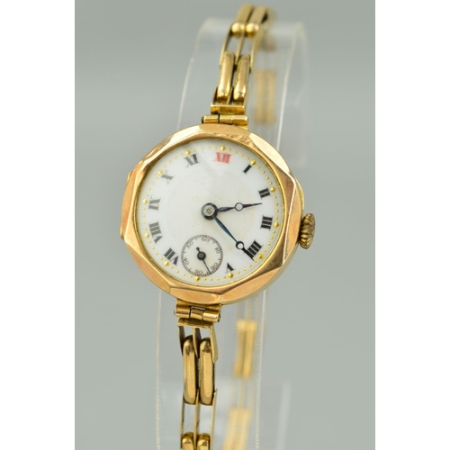 49 - AN EARLY 20TH CENTURY 9CT GOLD LADY'S WRISTWATCH, white enamel dial with Roman numerals and seconds ...