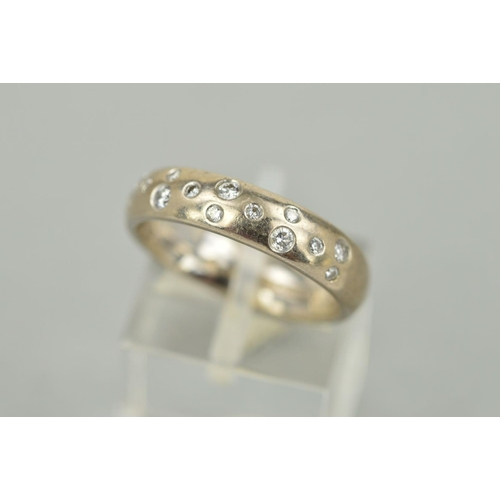 53 - A MODERN 18CT WHITE GOLD DIAMOND SET BAND RING, diamonds 'scatter' rub over set estimated total diam...