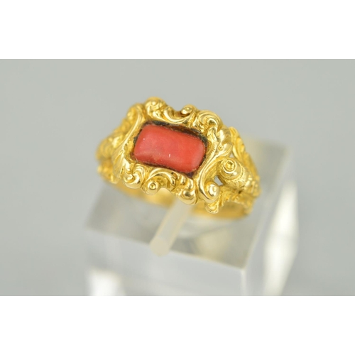 54 - A LATE GEORGIAN GOLD AND CORAL RING, centering on rectangular coral stone (which is a likely later r...