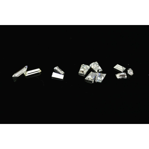 4 - VARI-CUT DIAMONDS, four tapered baguette cut, approximate total weight 0.33ct, colour assessed as H-...