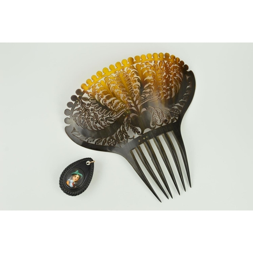 25 - AN EARLY 19TH CENTURY HORN HAIR COMB AND A LATE VICTORIAN BOG OAK PENDANT, the large hair comb with ...
