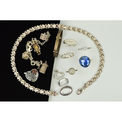 28 - A SELECTION OF SILVER AND WHITE METAL JEWELLERY to include an expandable child's bangle, a charm bra...