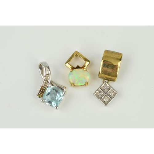 39 - THREE GEM SET PENDANTS to include an opal single stone, a 9ct white gold blue topaz and diamond, a d...