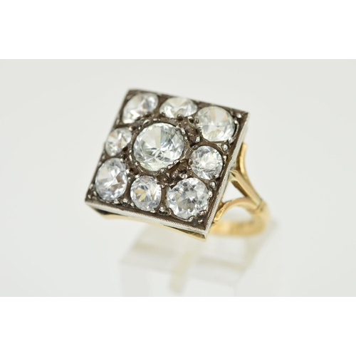 42 - AN EARLY 20TH CENTURY LARGE ZIRCON DRESS RING, square head measuring approximately 17.8mm in diamete...