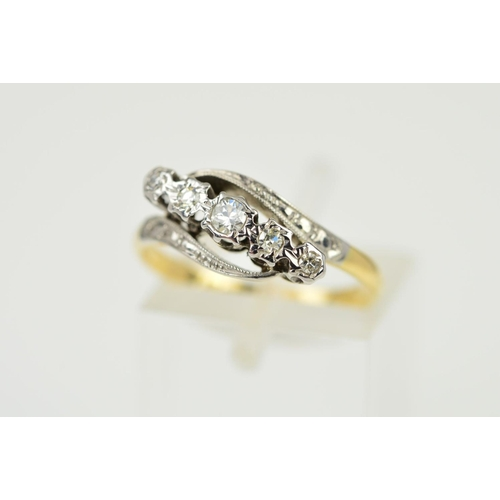 50 - A FIVE STONE DIAMOND CROSSOVER RING, the graduated diamonds within illusion settings, the centre a b...