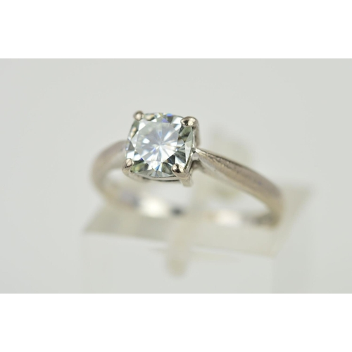 55 - AN 18CT GOLD SINGLE STONE SYNTHETIC MOISSANITE RING, the cushion cut moissanite within a four claw s...
