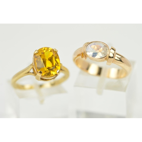 56 - TWO 9CT GOLD GEM RINGS, the first designed as an oval synthetic yellow sapphire within a four claw s...