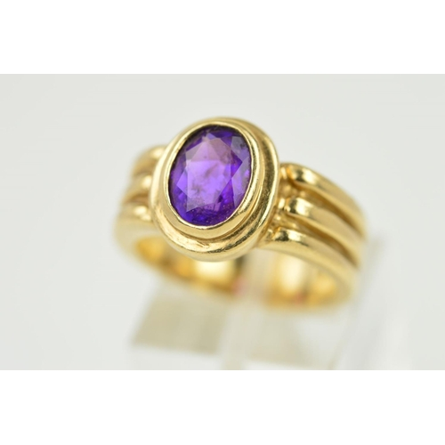 58 - AN AMETHYST RING, the oval amethyst within a collet setting to the triple banded shank, stamped 9ct,...