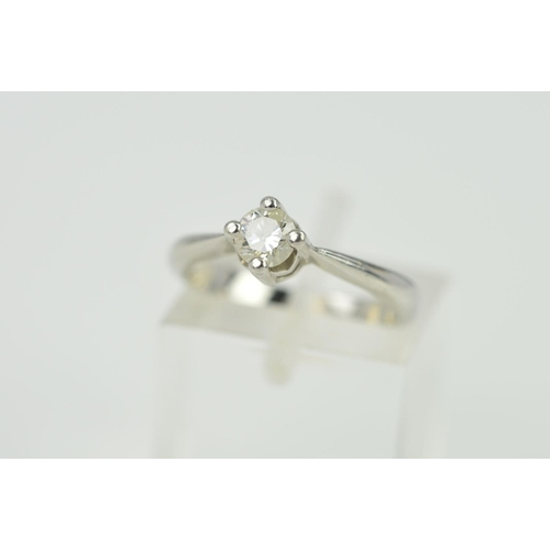 8 - A SINGLE STONE DIAMOND RING, the brilliant cut diamond within a four claw setting, diamond weight st...