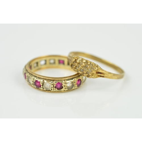 9 - TWO 9CT GOLD RINGS, the first with a textured front panel and tapered shoulders to the plain band, r...