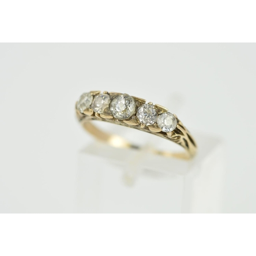 11 - AN EARLY 20TH CENTURY DIAMOND HALF HOOP RING, five old European cut diamonds, measuring from 3.0mm-3...