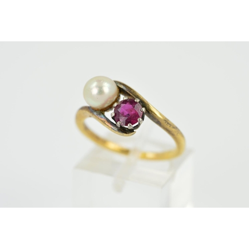 12 - A RUBY AND CULTURED PEARL TWO STONE CROSS OVER RING, a round mixed cut ruby measuring approximately ...