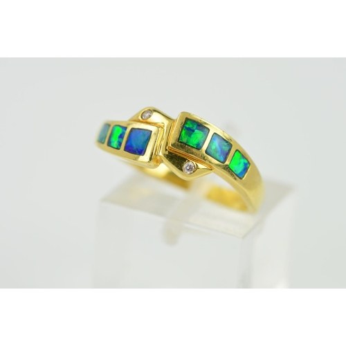 15 - A MODERN OPAL DOUBLET AND DIAMOND CROSS OVER DRESS RING, ring size O1/2, stamped '18k', approximate ...