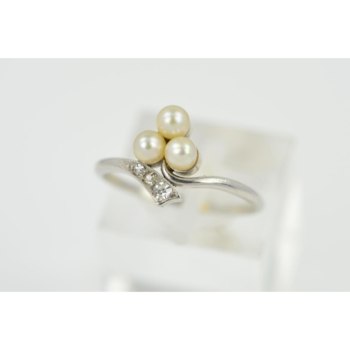 16 - AN EARLY 20TH CENTURY PEARL AND DIAMOND TREFOIL CROSSOVER RING, ring size L, personal inscription on...