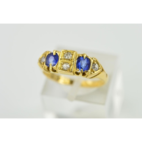 19 - A VICTORIAN 18CT GOLD SAPPHIRE AND DIAMOND HALF HOOP RING, two cushion cut sapphires, measuring appr...